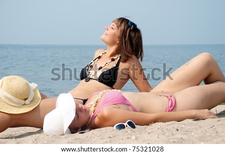 Happy girls on the beach - stock photo