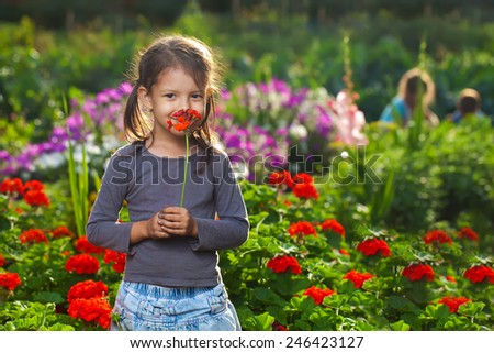 Happy girls on the meadow - stock photo