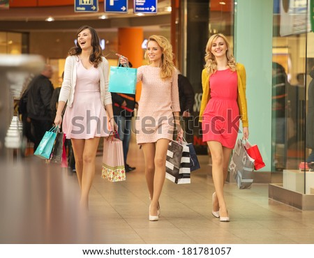 Happy girls shopping at the mall - stock photo