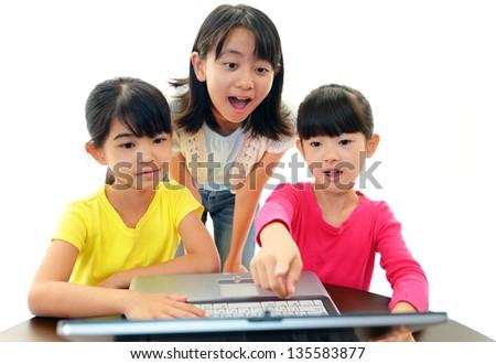 Happy girls using a laptop - stock photo