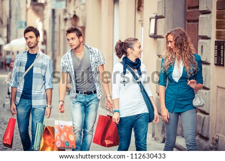 Happy Girls With Bored Boys on Shopping - stock photo