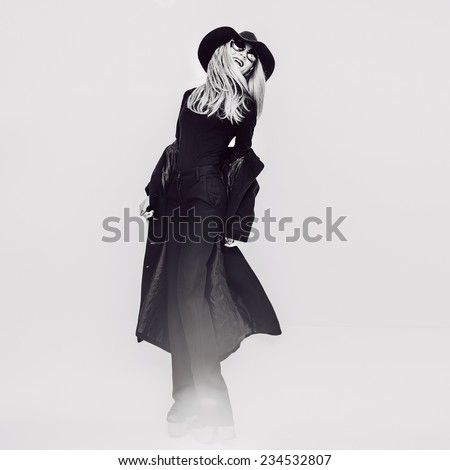 Happy Glamorous Lady in Coat and Hat. Black and white Vintage style - stock photo