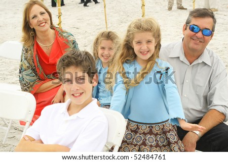 happy gorgeous family at the beach - stock photo