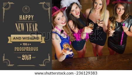 Happy gorgeous women holding flutes of champagne having hen party against art deco new year greeting - stock photo