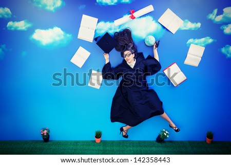 Happy graduate student is flying in the sky with her diploma and books. - stock photo