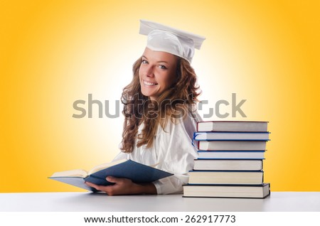 Happy graduate with lots of books on white - stock photo