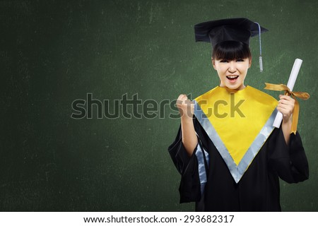 Happy graduated student girl with scroll on green chalkboard background - stock photo