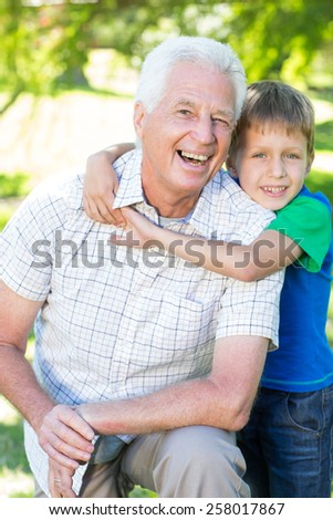 Happy grand father with his grandson on a sunny day - stock photo