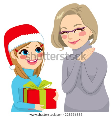 Happy granddaughter in Christmas day giving present to lovely grandmother - stock photo