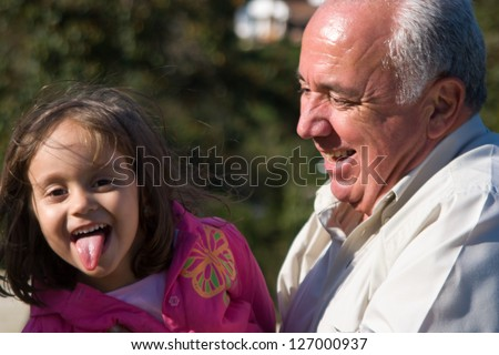 Happy Grandfather and grandchild, Enjoying At The Park - stock photo