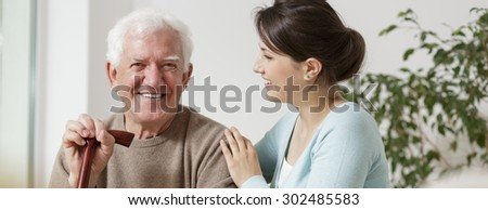 Happy grandfather and granddaughter spending time together - stock photo