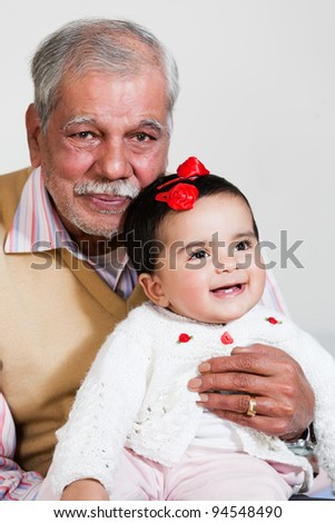 happy grandfather with grand daughter - stock photo