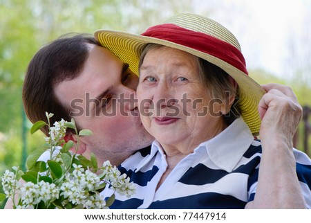Happy grandmother and happy smiling grandson - stock photo