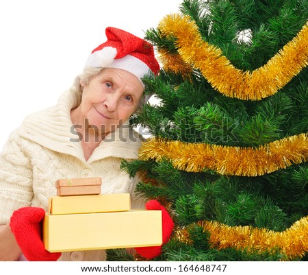 happy grandmother in Santa cap with Christmas gifts on white background - stock photo