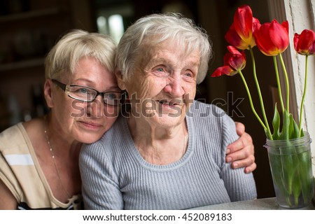 Happy grandmother with her adult daughter. - stock photo