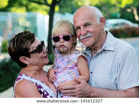 Happy Grandparents With Grandchild - stock photo