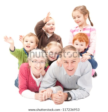 Happy grandparents with grandkids - stock photo