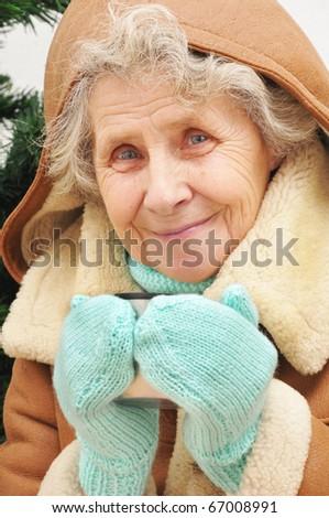 happy granny drinking hot tea - stock photo