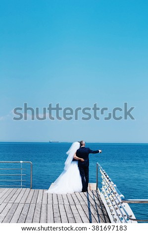 Happy groom and bride . Turquoise sea in the background. Wedding and honeymoon. A married couple, bride and groom. Bride and Groom.