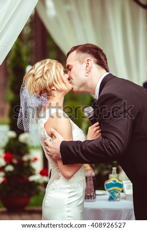 happy groom kissing  his beloved wife - stock photo