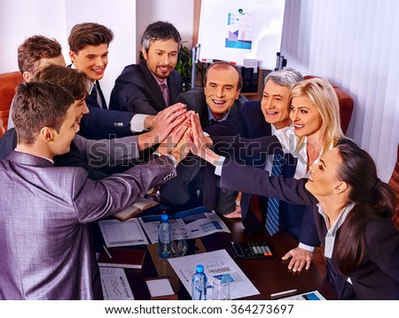 Happy group business people celebrating a successful project in office.  - stock photo