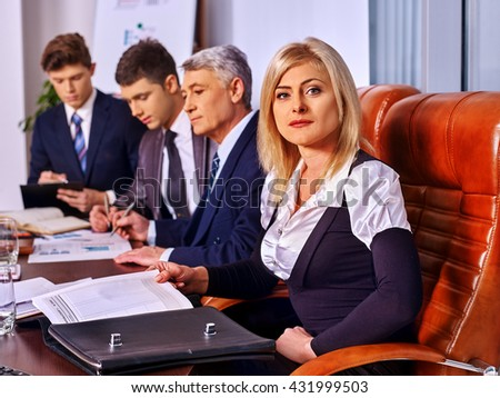 Happy group business people in office. Business woman on foreground. - stock photo