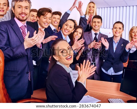 Happy group business people with hand together in office. - stock photo