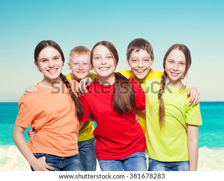 Happy group children at sea. Smiling teen. Frendship boys and girls - stock photo