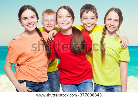 Happy group children at sea. Smiling teen. Friendship boys and girls - stock photo