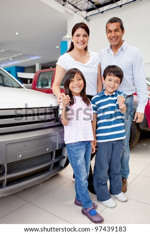 Happy group holding the keys of their new family car - stock photo