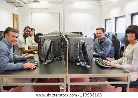 Happy  group in a computer room in college - stock photo
