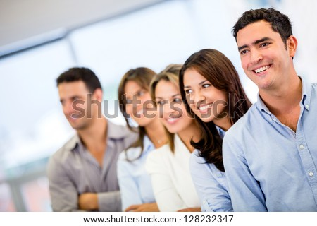 Happy group of business people smiling at the office - stock photo