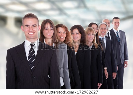 Happy Group Of Businesspeople Standing In A Row - stock photo