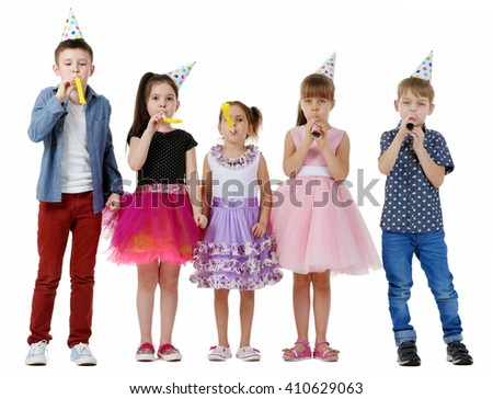Happy group of children with noise makers having fun at birthday party, isolated on white - stock photo