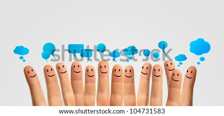 Happy group of finger smileys communicate with each other - stock photo