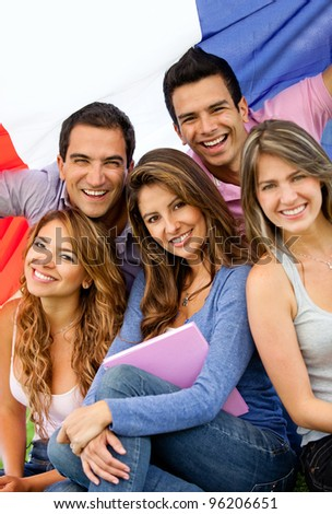 Happy group of French students with the flag of France - stock photo