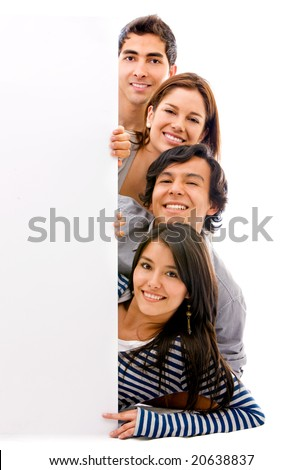 happy group of friends holding a banner add on the floor - stock photo