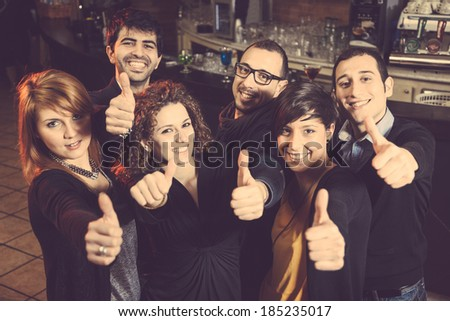 Happy Group of Friends in a Night Club - stock photo