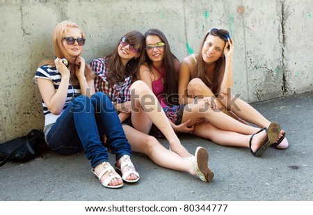 happy group of friends smiling outdoors - stock photo