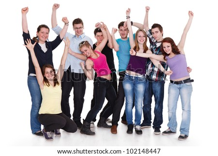 happy group of friends with arms up isolated over a white background - stock photo