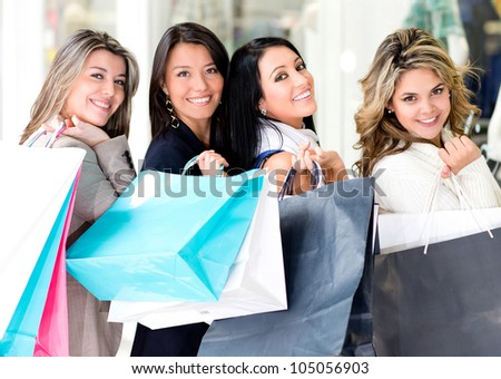 Happy group of girls at the shopping center - stock photo