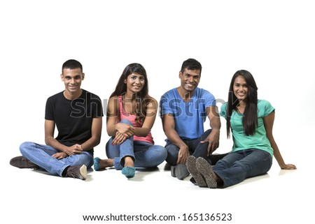Happy group of Indian friends. Isolated on a white background. - stock photo