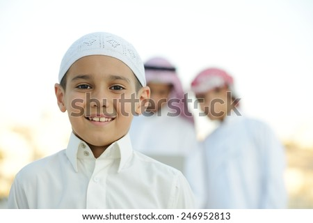 Happy group of Middle eastern Gulf boys - stock photo