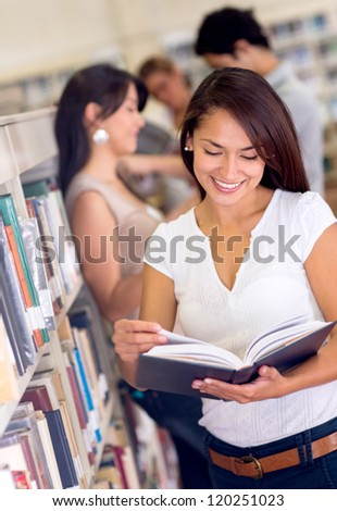 Happy group of people at the library - stock photo