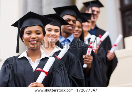 happy group of university graduates at graduation ceremony - stock photo