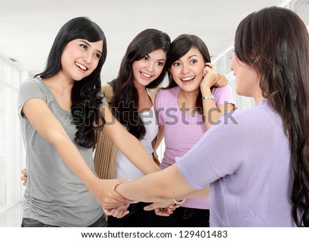 Happy group of woman meet old friend somewhere - stock photo