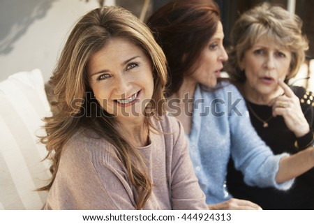 Happy group of women having fun and talking outdoors - stock photo