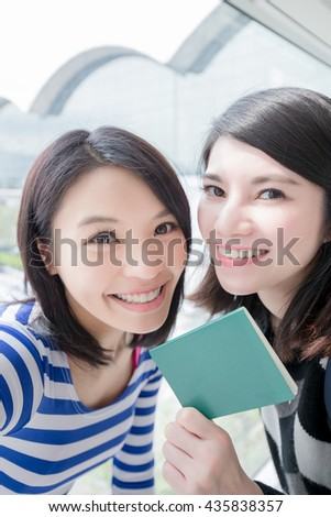 Happy group travel women hold passport and take a selfie.  - stock photo