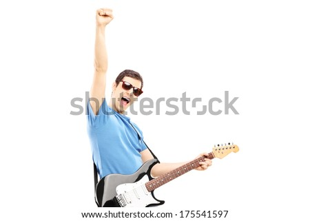 Happy guy playing on an electric guitar isolated on white background - stock photo