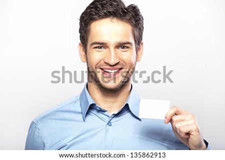 Happy guy with empty card - stock photo